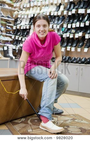 Woman Trying Shoes For Size