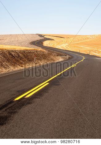 Open Road Two Lane Highway Oregon Landscape Harvested Farmland