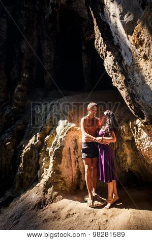 Woman And Man Hug In Cave
