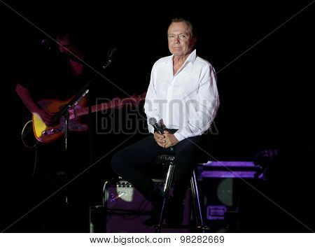 MASSAPEQUA PARK, NY-AUG 8: Musician David Cassidy performs onstage at John J. Burns Park at the Town of Oyster Bay'??s Music Under the Stars series on August 8, 2015 in Massapequa Park, New York.
