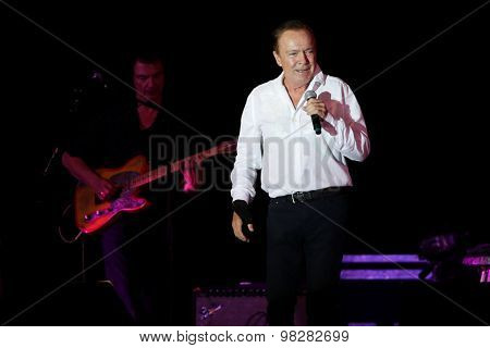 MASSAPEQUA PARK, NY-AUG 8: Musician David Cassidy performs in concert at John J. Burns Park at the Town of Oyster Bay'??s Music Under the Stars series on August 8, 2015 in Massapequa Park, New York.