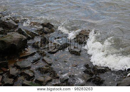 Waves of water on rocks
