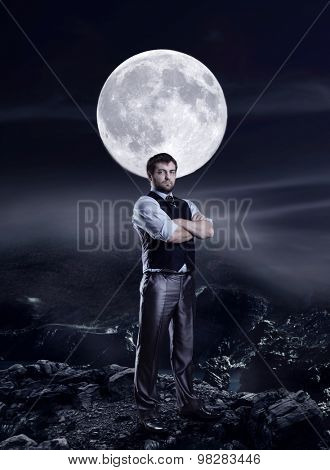 Businessman in the night agaist a big moon