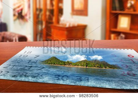 Calendar  with beautiful  landscape  on the table