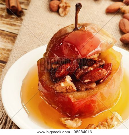 Dessert Of Baked Apples Stuffed With Nuts And Drizzled With Honey