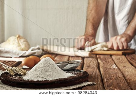 A Handful Of Flour On A Rustic Kitchen