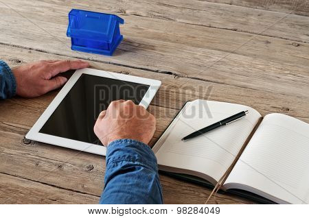 White tablet computer in the hands of men