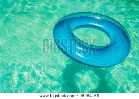 Inner Tube In Swimming Pool.
