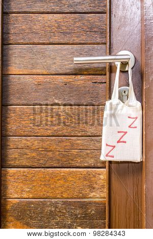 Do not disturb, sign hang on door knob.