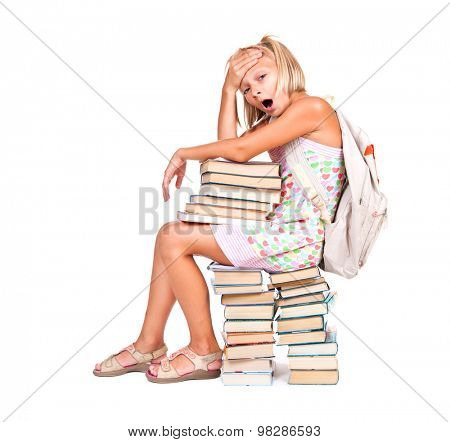 Back to school. Tired Schoolgirl with rucksack and stack of books isolated on a white background. Education concept, knowledge. Full length portrait of Pupil School girl sitting on stack of books