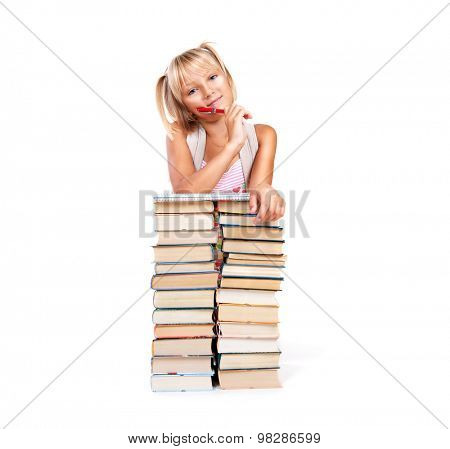 Back to school. Happy Smiling Schoolgirl with a pen and stack of books isolated on a white background. Education concept, knowledge. Pretty school girl portrait