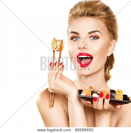 Beauty Woman eating Sushi. Beauty Fashion model girl eating Sushi rolls. Chopsticks. Beautiful sexy surprised lady with perfect make up eating healthy japanese food. Diet, dieting concept