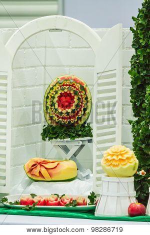 Cantaloupe, watermelon and papaya fruit carving.