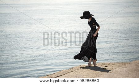 Ballerina In Hat And Black Dress.