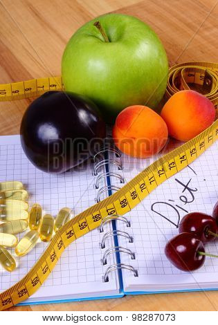 Fruits, Tablets Supplements And Centimeter With Notebook, Slimming And Healthy Food