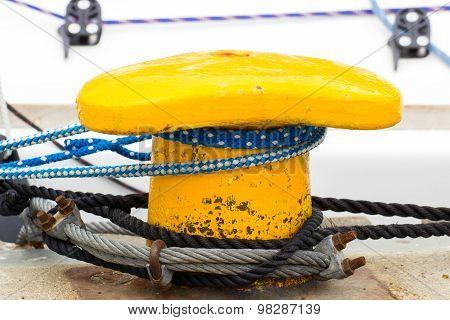 Yachting, Colorful Rope And Yellow Mooring Bollard