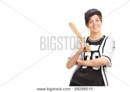 Young woman in a baseball jersey holding a bat and leaning against a wall isolated on white background