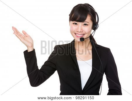 Call center operator with hand showing something