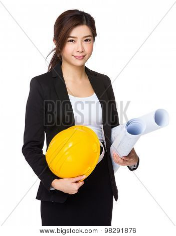 Asian Young enginner with yellow helmet and blue print
