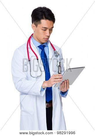 Male Doctor use of the digital tablet
