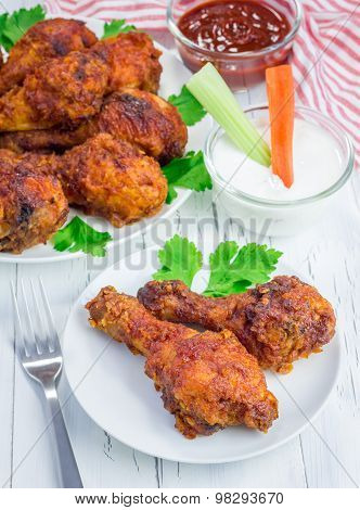 Roasted Chicken Served With Celery And Carrot Sticks, Blue Cheese Dressing And Hot Sauce