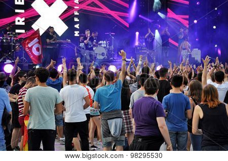 Party People At A Live Concert