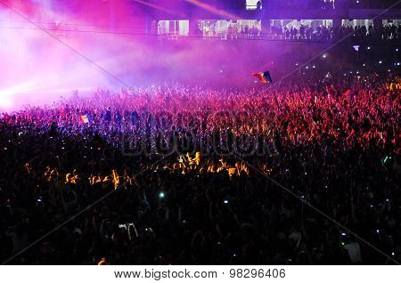 Crowd Of People Raising Their Hands At A Concert