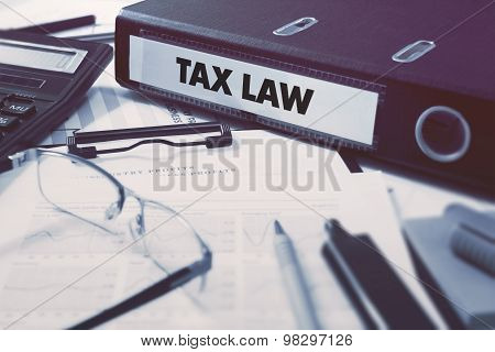 Office folder with inscription Tax Law.