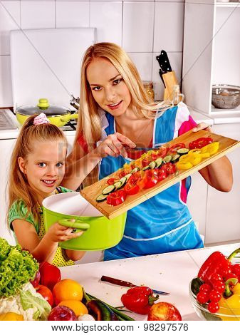Mother and daughter cooking food at kitchen. Family cooking at home