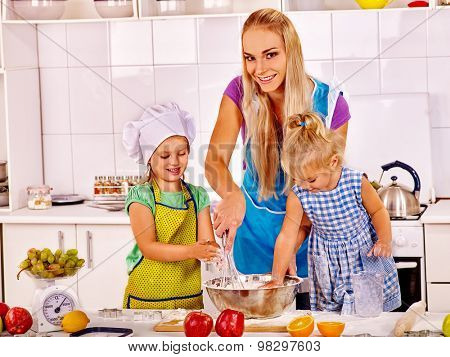 Mother and granddaughter baking cookies. Family cooking at home