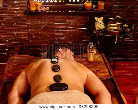 Man  having oil Ayurveda treatment. Spa resorts in India