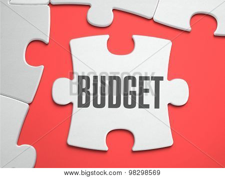 Budget - Puzzle on the Place of Missing Pieces.