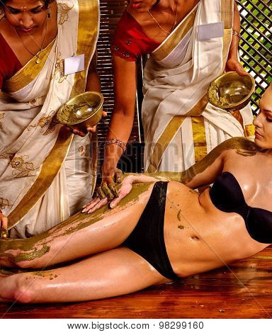 Young woman having body Ayurveda massage.Spa resorts in India