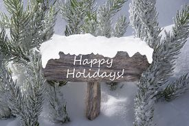 stock photo of snow forest  - Wooden Christmas Sign With Snow And Fir Tree Branch In The Snowy Forest - JPG