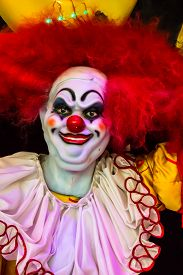 stock photo of clowns  - Scary clown robot in clown mask on Halloween day - JPG