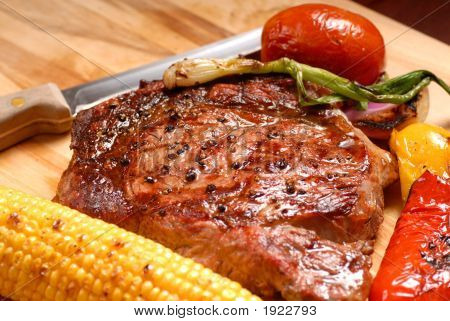 Grilled Bbq Ribeye Steak With Vegetables And A Knife