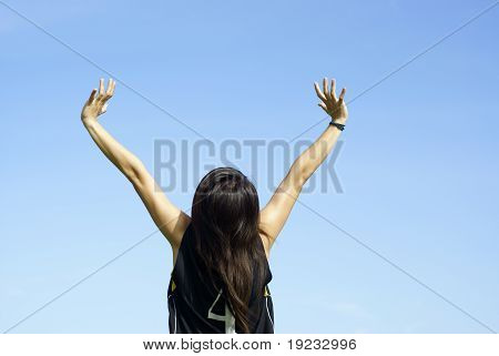 Happy teen girl with outstretched arms