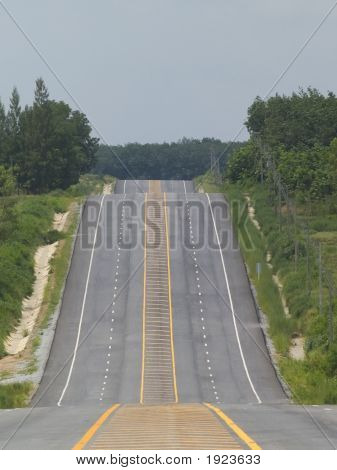 Empty Road Over A Hill