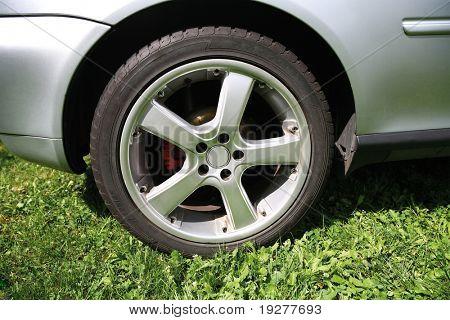 Close up wheel of a silver car