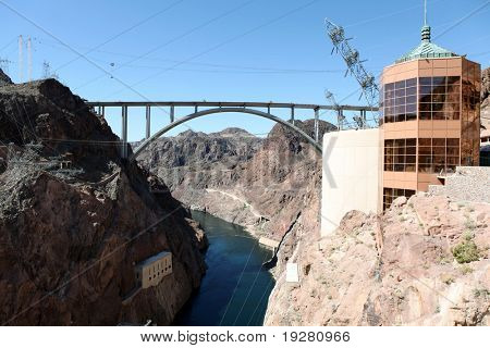 View down the new highway bridge from high on top historic Hoover Dam in Nevada.