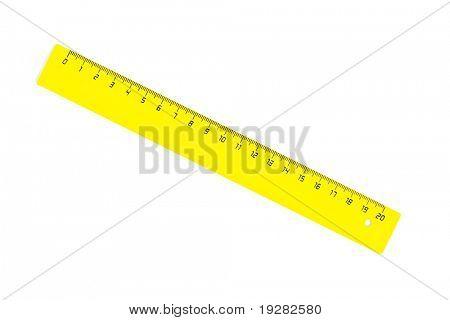 Diagonal yellow twenty centimeters ruler isolated on white