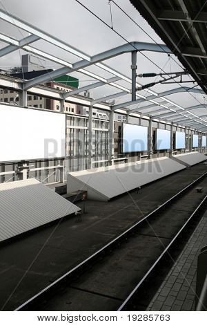 Blank billboards in a subway station