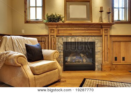 Office with comfortable chair and fireplace