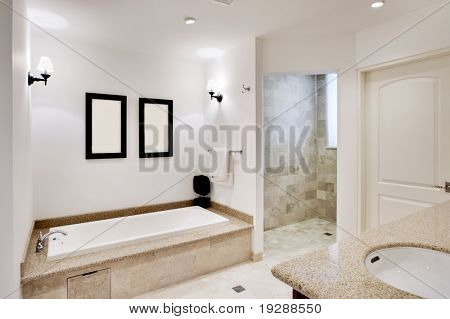 Wide view of bathroom with bath and shower