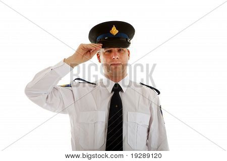 Police Officer With Hand On Cap