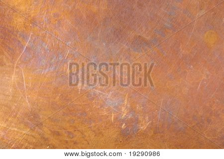 Heavily worn copper texture surface. Even focus across surface.
