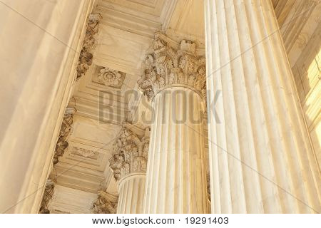 Supreme Court Column Details. Sunset orange light cast across scene.
