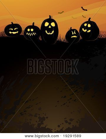 Pumpkins atop dark hill with black copy space below