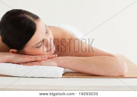 Lovely dark-haired woman getting a spa treatment