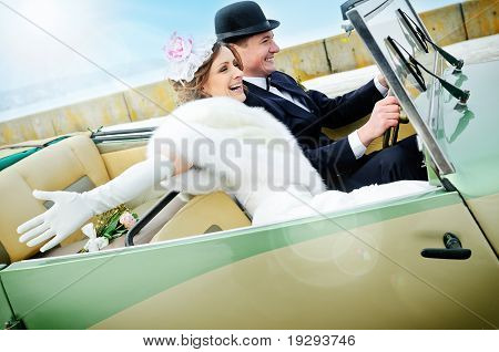 Newlyweds In Wedding Car